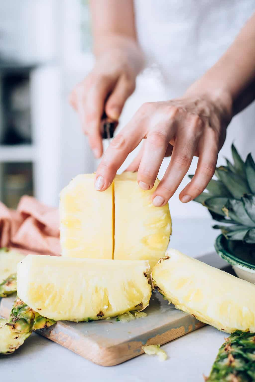 Quartering a pineapple