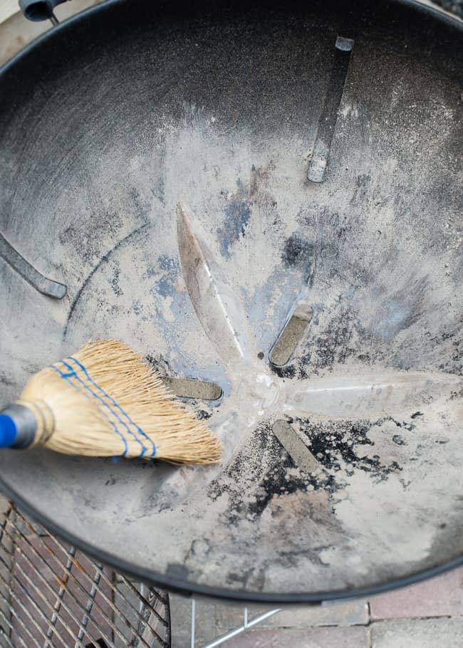 how to clean a grill - sweep ashes