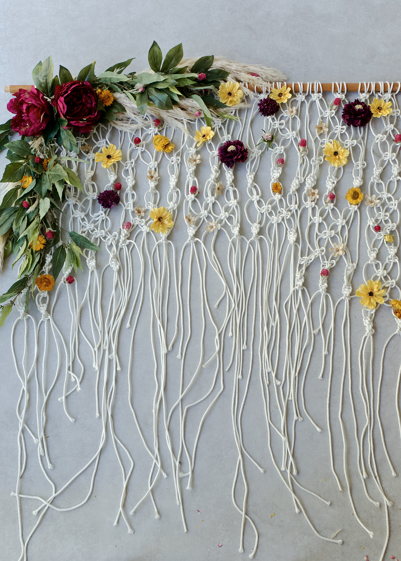 DIY Silk Floral Macramé Backdrop from Green Wedding Shoes | 8 Modern DIY Macrame Projects