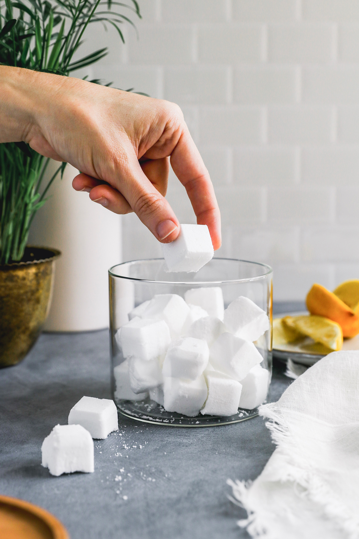 Hate doing dishes? We do too. Do them in record time with these DIY dishwasher pods made with non-toxic ingredients you probably already have!
