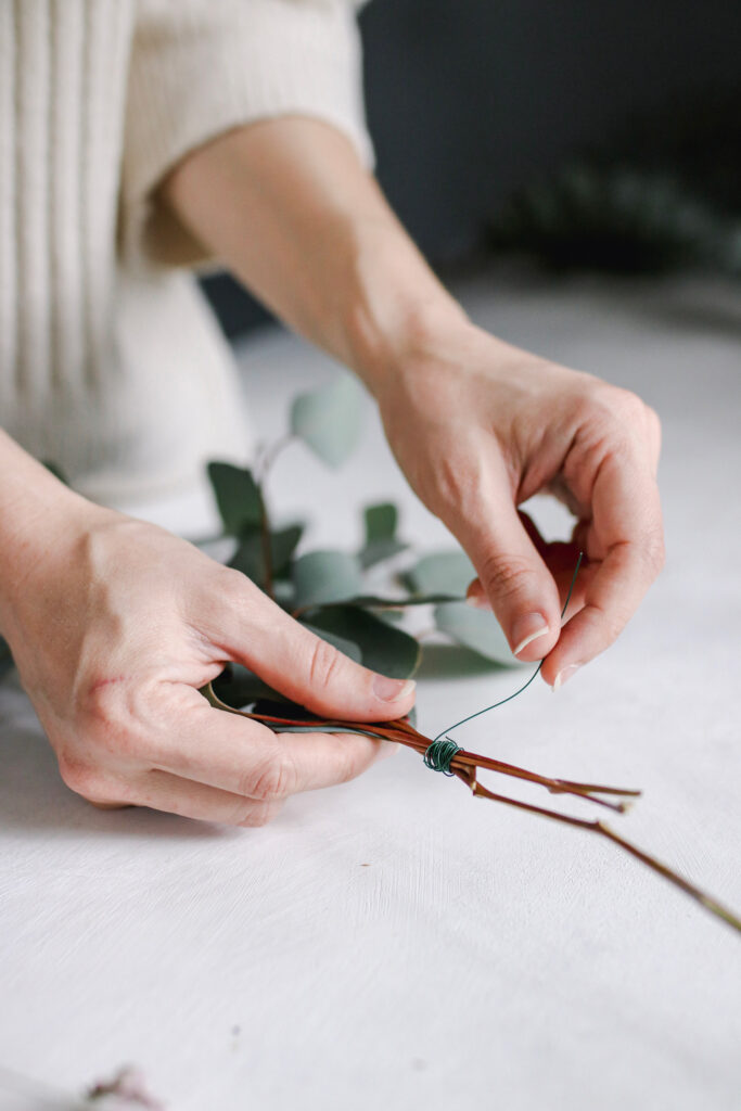 Wiring eucalyptus together for wreath