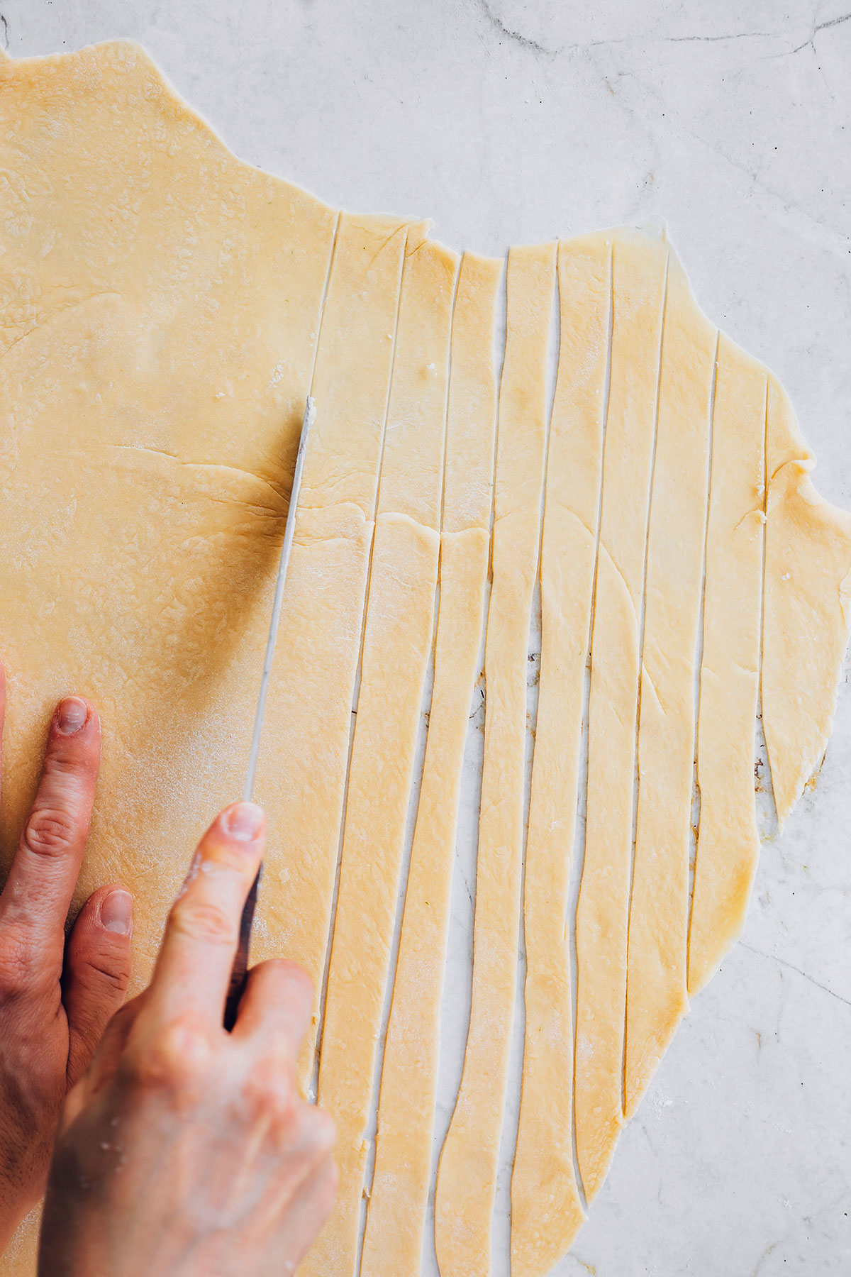 Cutting homemade pasta strips