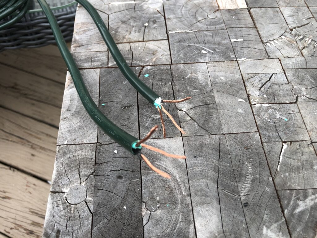 Exposing copper wire to repair an extension cord